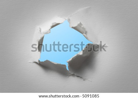 hole in white paper - stock photo