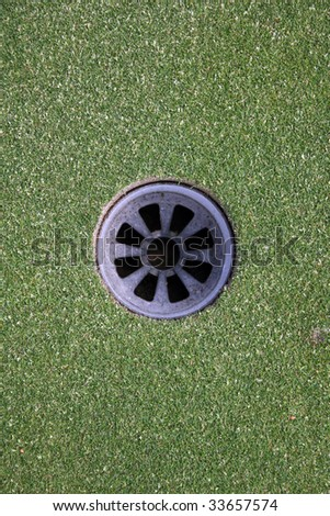 Hole on the green - stock photo
