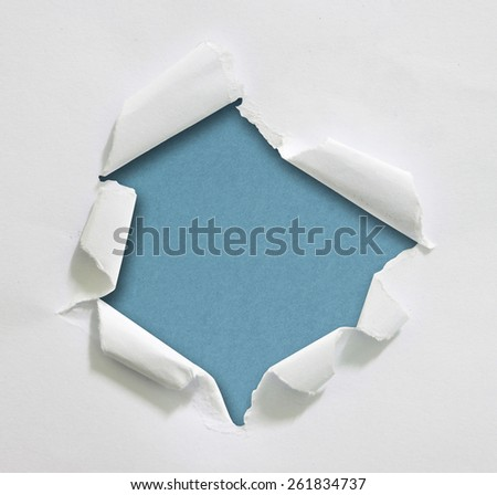 Hole ripped in paper - stock photo