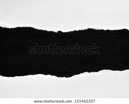Hole ripped in paper. Advertising space - stock photo