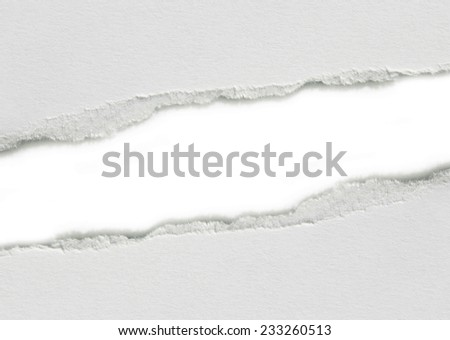 Hole ripped in paper. Copy space - stock photo