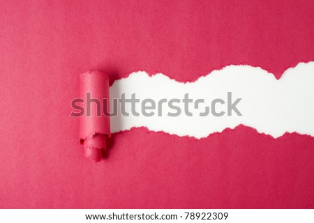 Hole ripped in red paper on white - stock photo
