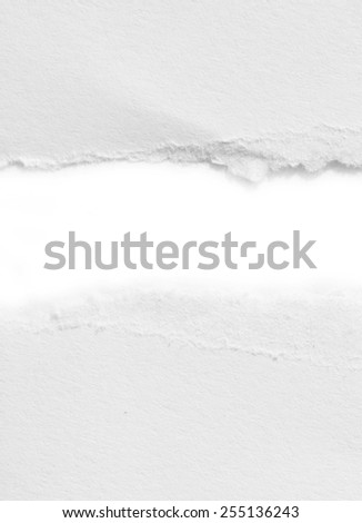 Hole ripped in white paper - stock photo