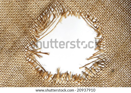 Hole torn in sackcloth - stock photo
