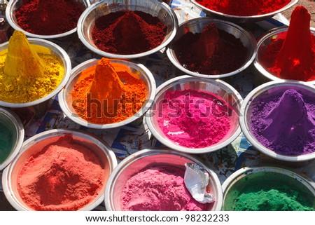 Holi India colored colorful powder kumkum on Indian bazaar for festival celebration - stock photo