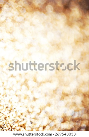 Holiday abstract glitter background with blinking lights and gold defocused texture. Golden Glitter festive bokeh   - stock photo