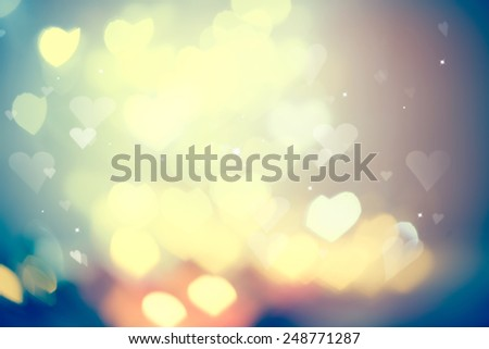 Holiday abstract glowing blurred background, bokeh. Defocused blinking heart shaped lights, vintage toned. Valentine Hearts Abstract Background. St.Valentine's Day Wallpaper. Heart Holiday Backdrop - stock photo