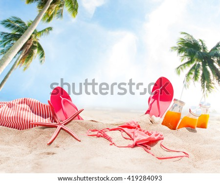 Holiday Accessories on Sand Beach Orange Juice Bikini Slippers Sea Star Sunny Summer Day Relax Concept Art Collage Palm Background - stock photo
