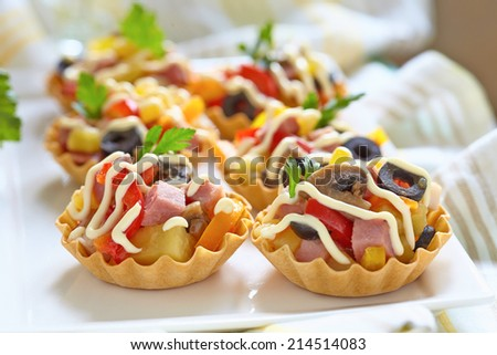 Holiday Appetizers with ham, mushroom, pepper, olive crab and potato - stock photo