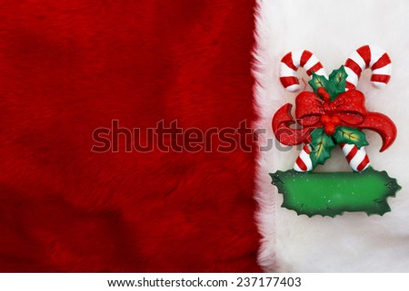 Holiday Background, A plush red stocking with a Candy Canes with copy-space - stock photo