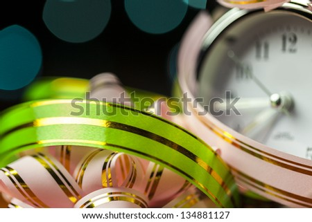 Holiday Background with colorful ribbons and clock - stock photo