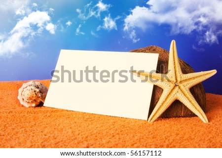 holiday beach concept with shells, sea star and a blank postcard on a beach towel - stock photo