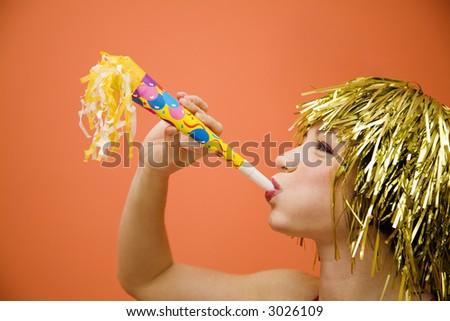 Holiday: beautiful girl having fun at a carnival party - stock photo