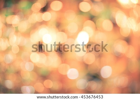 Holiday blurred bokeh background. Christmas background. Horizontal. Warm old-fashioned tone with orange and green - stock photo