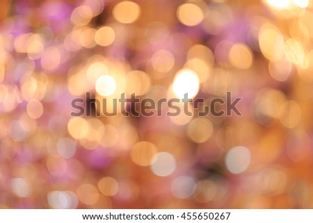 Holiday blurred bokeh background. Christmas background. Horizontal. Warm orange tone with pink and yellow - stock photo