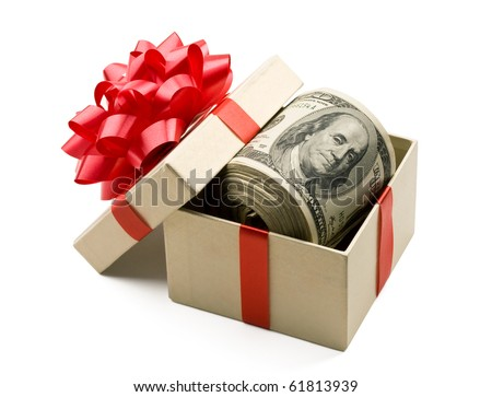 Holiday bonus.  Money roll laying in red bow decorated gift box. - stock photo