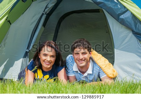 Holiday camping - Man And Woman Couple Camping In A Tent In The Countryside - stock photo