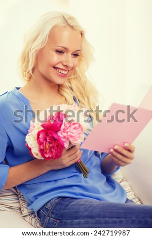 holiday, celebration, home and birthday concept - smiling young woman with greeting card and bouquet of flowers - stock photo