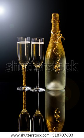 Holiday champagne bottle and two champagne glass - stock photo