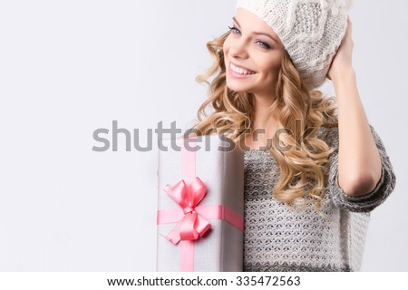 Holiday / Christmas / Winter. Portrait happy woman with gift box in hands.  - stock photo