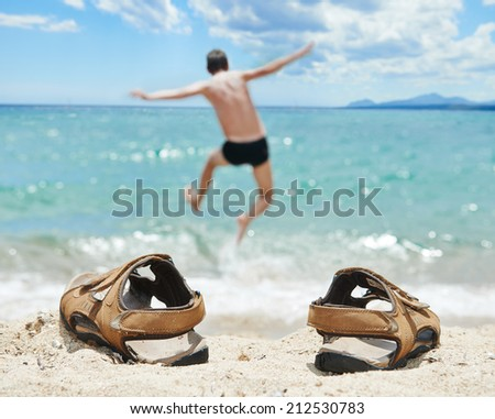 holiday concept. man jumping into the torquoise tropic sea at vacation - stock photo