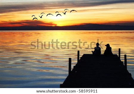Holiday couple in the sea - stock photo