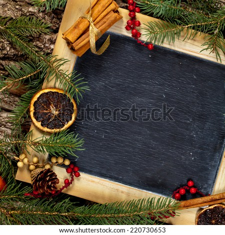 Holiday Decorations. Christmas composition with chalkboard. Selective focus. - stock photo