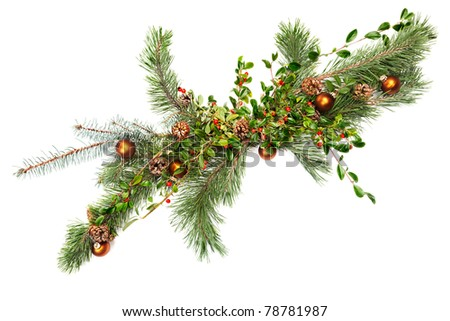 Holiday garland with ornaments, pine & spruce branches, pine cones and evergreen with berries (Common Bearberry/Kinnikinnick).  Shot straight down but at an angle to get maximum length in frame. - stock photo