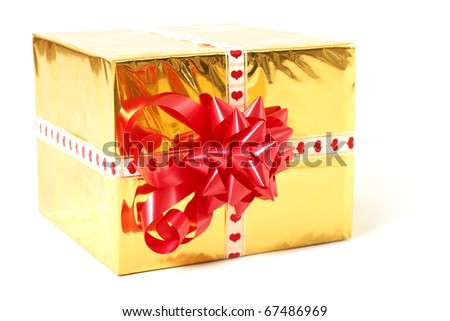 holiday gift in box with gold foil and red bow isolated on white background - stock photo