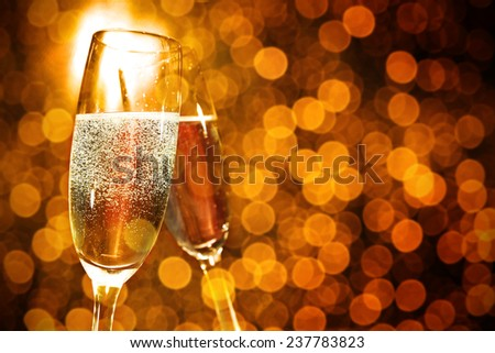 holiday golden background and glasses of champagne  - stock photo