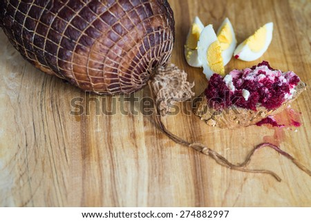 Holiday ham with fresh crusty bread , eggs and condiments - stock photo