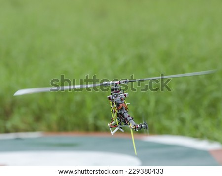 Holiday helicopter radio playing - stock photo