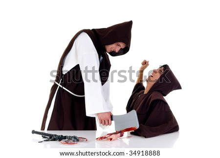 Holiday horror Halloween scene, two priests in habit, one chopping of hand of colleague.  Studio, white background. - stock photo