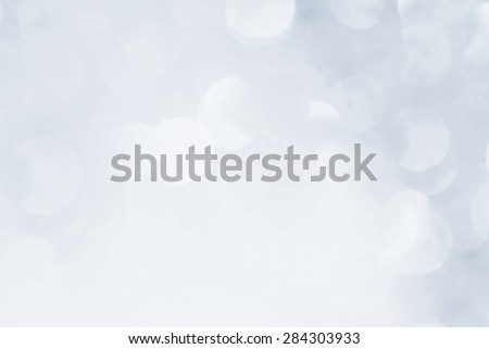 Holiday light bokeh, blurred blue background - stock photo