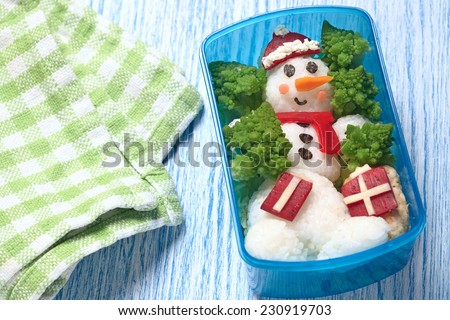 Holiday lunch box with snowman for kids - stock photo