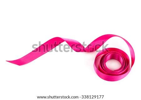 Holiday pink ribbon isolated on white background. - stock photo