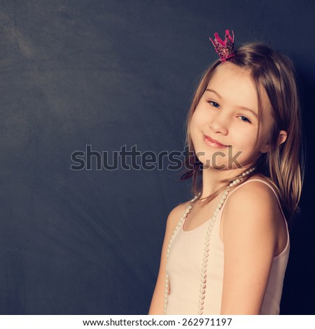 Holiday portrait of young girl with cute smile - stock photo