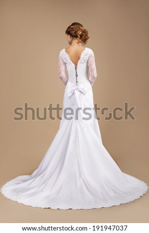 Holiday. Rear View of Auburn Woman in Long Festive Dress - stock photo