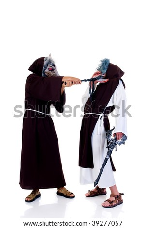 Holiday scene, two Halloween characters,  priests in habit fighting.  Studio, white background. - stock photo