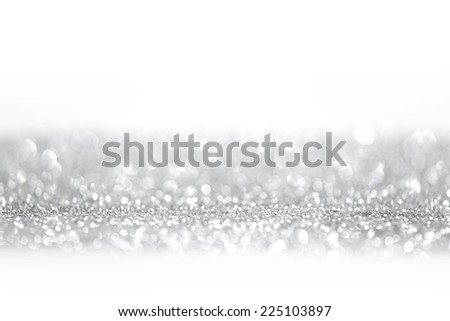 Holiday silver glitters isolated on white background - stock photo