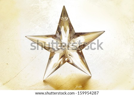 Holiday star on golden background.  - stock photo
