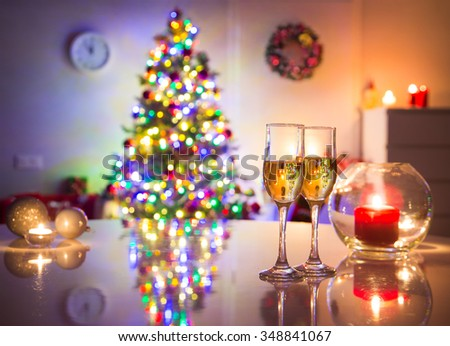 holiday table glasses of champagne on the background of Christmas tree - stock photo
