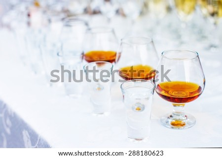 Holiday table setting. Glasses set in restaurant with alcohol - stock photo