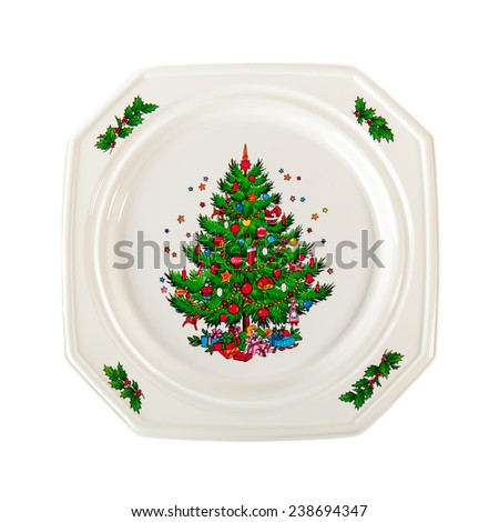 Holiday  white plate with Christmas tree ornament isolated on white background - stock photo