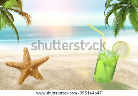 Holiday with starfish and juice on the beach  - stock photo