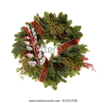 holiday wreath decorated with ribbon and berries - stock photo