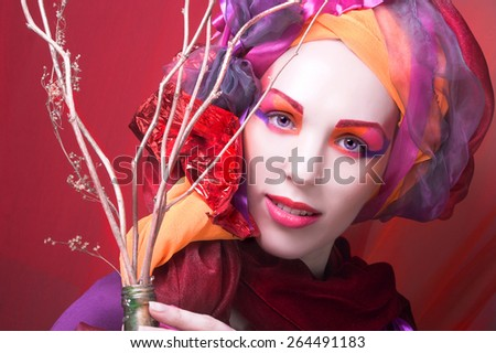 Holiday. Young woman with artistic visage posing with brunch - stock photo
