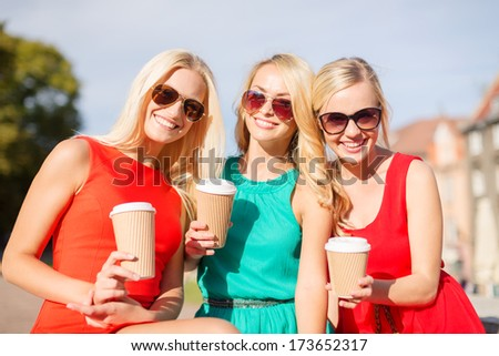 holidays and tourism, friends, blonde girls concept - beautiful women with takeaway coffee cups in the city - stock photo
