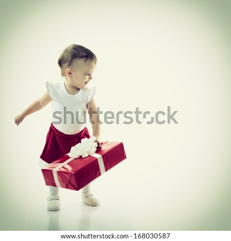 Holidays, baby girl make a present, christmas, birthday, new year, x-mas concept - happy child girl with gift boxes  - stock photo