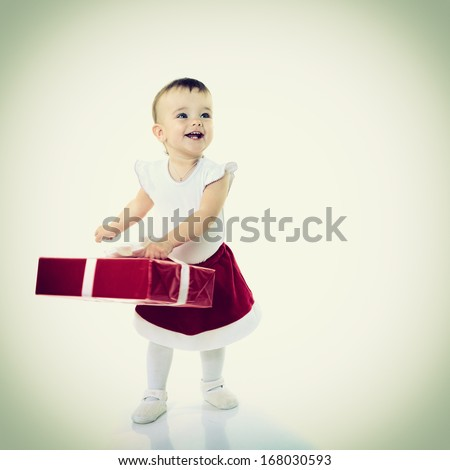 Holidays, baby girl with presents, christmas, birthday, new year, x-mas concept - happy child girl with gift boxes  - stock photo